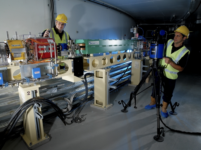 Jason Giles and Antony Mariani in the booster synchrotron