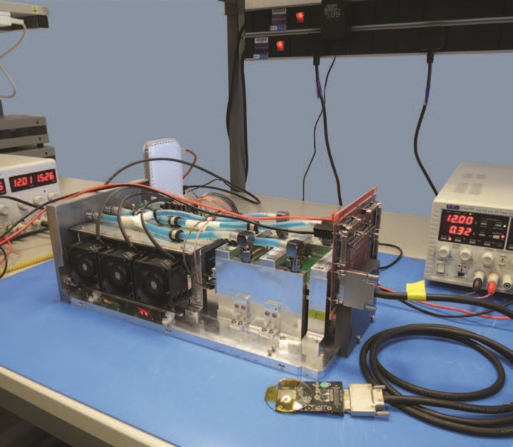 Figure 3: Chassis of the Tristan 1M with all the electronics installed. The system currently drives a single Timepix3 chip connected to the rest of the electronics through an adapter board and a cable as shown in the picture.